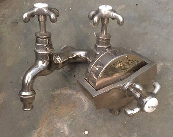 Antique faucet with patented water filter, early 20th century curiosity.