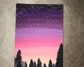 Evening sky with stars & evergreens.