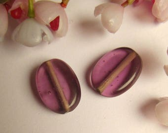 set of 2 oval shaped purple glass beads