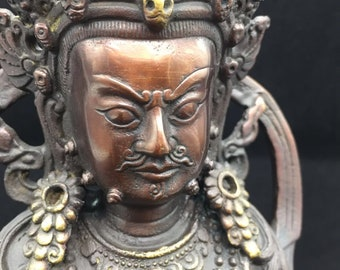 copper and bronze Buddhist statue Jambala