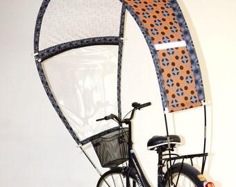 Kaps avec motifs oranges et gris pour vélo