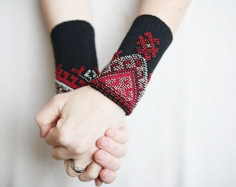 Red and black hand knitted Baltic fingerless wrist warmers with beads made in Lithuania using Italian wool