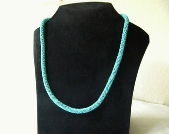 crocheted necklace from turquoise glass beads (1mm) and inserted, silver lined glass pins