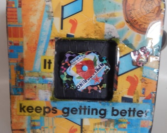 Recycled Magazine Collage on Frame w Recycled Aluminum Flower