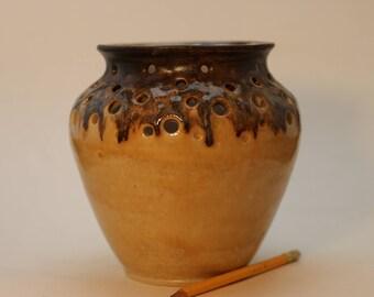 Copper over yellow ceramic vase.