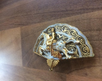 Damascene fan shaped vintage brooch with horse and rider