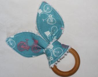 Blue Whimsical Wheels Rabbit Ears Wooden Teething Ring