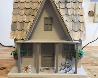 Cottage diorama that hangs on wall with flat back