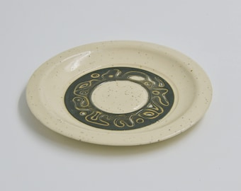 Speckled sgraffito pottery plate