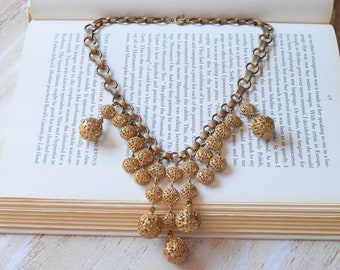 1940s Filigree Bauble Brass Necklace