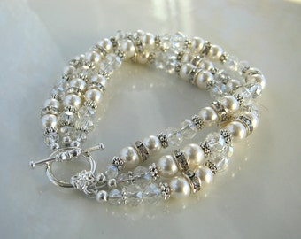 Three Strand Crystal, Rhinestone and White Pearl Bracelet made with Swarovski Elements Crystal White Pearls