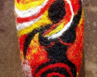 Latest wild woman drumming on this felted wool drum beater on a driftwood handle.