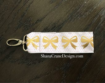 One Clip-On Lip Gloss Holder . Gold Bows