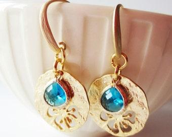 Blue earrings.  Flower charm earrings.  Gold pendant earrings.