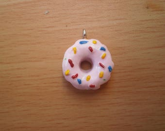 Pink donut charm and multicolored sprinkles