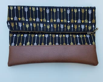 Fold over clutch with wristlet