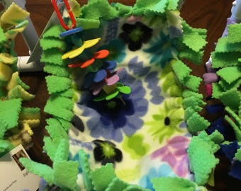 A Greencheek sized Bird Tabletop Playgym green floral design Hammock