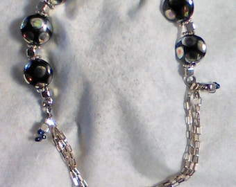 Memory wire and sterling chain fusion bracelet.