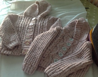 Girls Aran jackets in pale pink tweed.