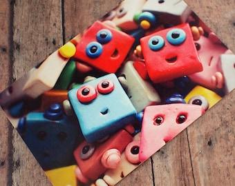 Happy Robot Faces Pile Up Art Postcard