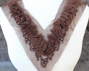 Cute  embroidered  and beaded  applique brown  color
