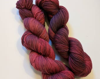 Muted Red on Max 80/20 SW Merino Nylon Hand dyed fingering weight sock yarn