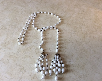 Lariat white beaded necklace.  Many ways to wear this mid century classic.  Lovely.