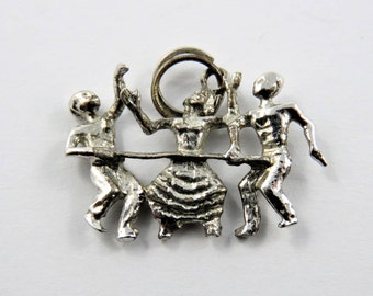 Beach Goers Doing the Limbo Sterling Silver Charm of Pendant.