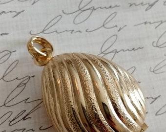 5 dollar sale... Avon vintage perfume shell  pendant