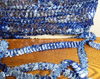 """Vintage Blue stretch sequin trim, 15 yards x 3/4"""".  Is irregular in width in some places."""