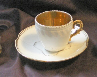 Three Different Small Cups and Saucers