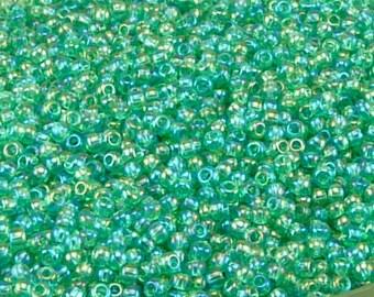 TOHO 11/0 Round Seed Beads - Transparent Rainbow Dark Peridot Green - 20 gram Bag - Spring Grass Easter St Patricks - Color Code 164B Jar 58