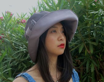 Rain hat grey-parme with bow