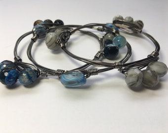 Set of three blues/grays wire wrapped bracelets