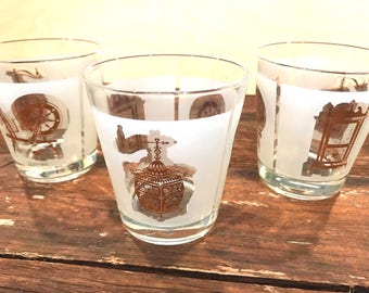 Set of three (3) vintage, mid century modern drinking glasses, frosted, gold images of spinning wheel, clock, coffee grinder, made in France