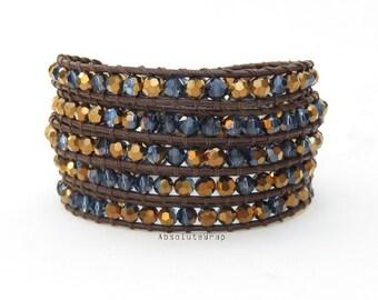 Metallic brown blue crystal wrap bracelet on dark brown leather cord, dark blue crystal