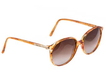 Genuine Versace sunglasses 80s, made in Italy. 100% original never worn vintage accessory