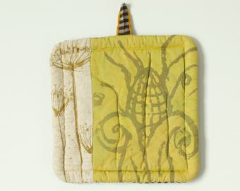 big mustard yellow and natural linen hot pad hand dyed and printed with with corn and Queen Anne's lace