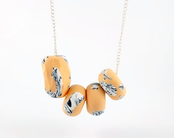 Polymer clay statement necklace in peach, with black & white marble detail/ silver plated chain/ faceted beads/ beaded necklace/ zebra print