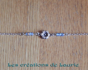 Silver flower and blue transparent beads