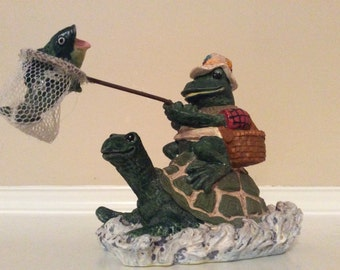 Cute!  A Frog Hitching A Ride with a Turtle  Holding a Fish in a Net Over his Head Figurine.