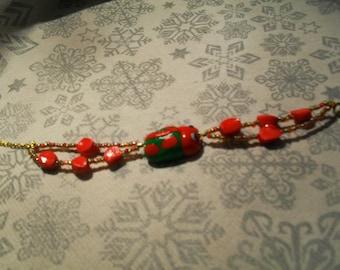 """Ladybug"" red and green bracelet"
