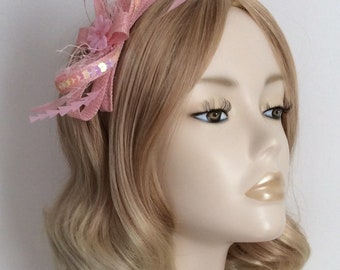 BABY PINK FASCINATOR, Made with sinamay,Feathers,sequins and net,on a comb