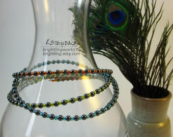 Neon Rave Chokers; Gorgeous bright colours interspersed with hematite on memory wire gives a luminous glow as a simple choker.