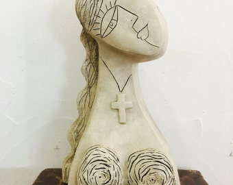 Girl wearing Her cross Necklace Clay Sculpture