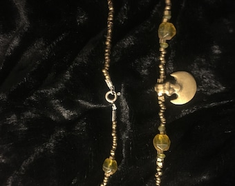 Antique tribal bronze, mexican amber and brass.