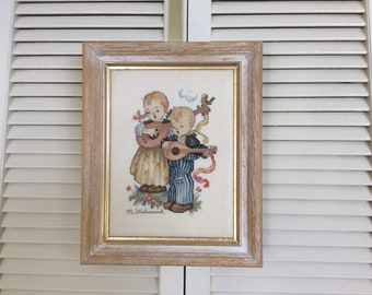 Finished and Framed Cross Stitch - Hummel: The Strummers - 2 Kids Playing Musical Instruments