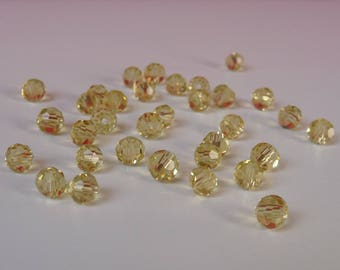 30 clear 4mm yellow faceted bicone beads