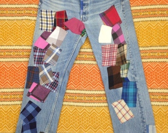 One of a kind flannel patched Levi's boyfriend jeans