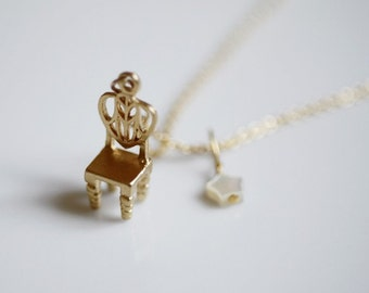 sweet little 18k gold chair necklace